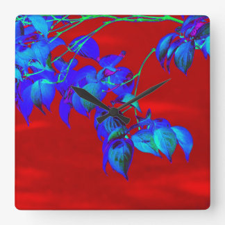 Red Sky Blue Leaves Wall Clock
