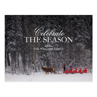 Red Sleigh ride near snow covered forest. Postcard