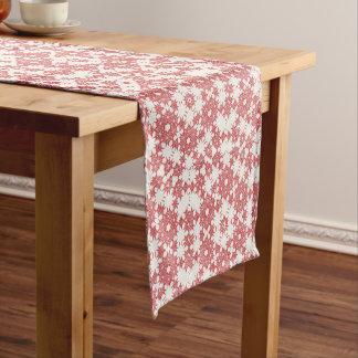 Red snowflakes on white short table runner