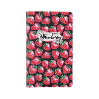 Red strawberry on  black background large moleskine notebook