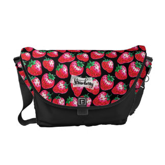 Red strawberry on  black background messenger bag