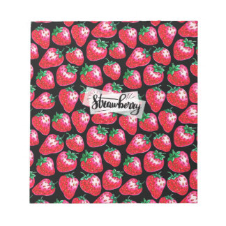 Red strawberry on  black background notepad