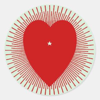 Red sunburst heart: altered 1914 graphic art round sticker
