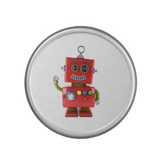 Red toy robot waving hello speaker
