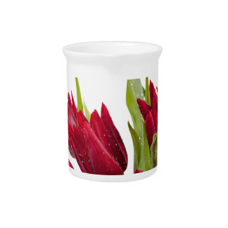 Red tulips bouquet pitcher