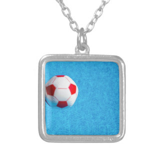 Red-white beach ball floating  in swimming pool silver plated necklace