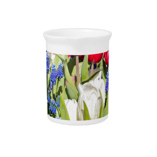 Red white blue flowers in spring season drink pitchers