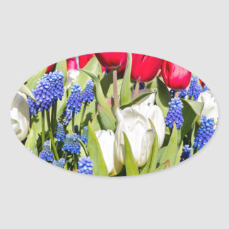 Red white blue flowers in spring season oval sticker