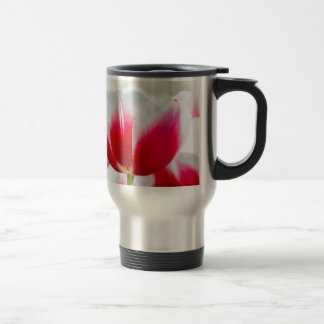 Red with white tulip in front of field travel mug