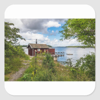 Red wooden cottage in Sweden Square Sticker