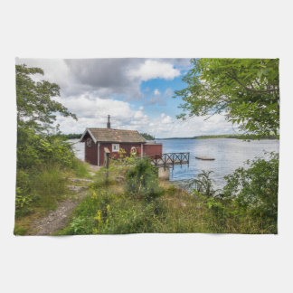 Red wooden cottage in Sweden Tea Towel