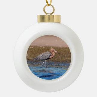 Reddish Egret on North Beach Ceramic Ball Christmas Ornament