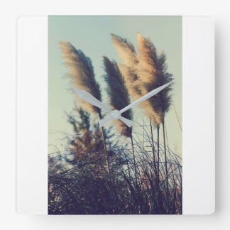 Reeds in the wind square wall clock
