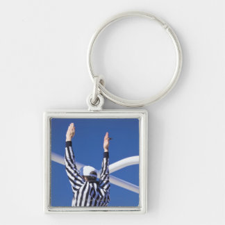 Referee signaling touchdown or successful field key ring