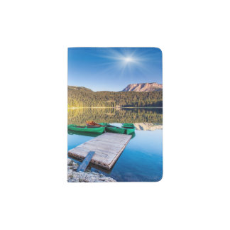 Reflection in water of mountain lakes and boats passport holder