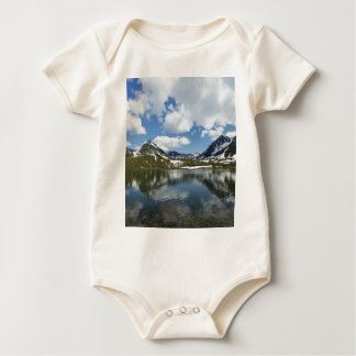 Reflection of sky and clouds in mountain lake baby bodysuit