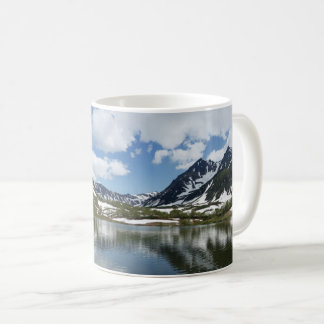 Reflection of sky and clouds in mountain lake coffee mug