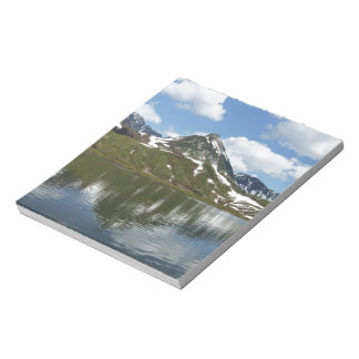 Reflection of sky and clouds in mountain lake notepad