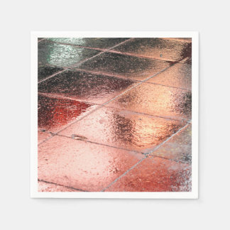 Reflections in a wet pavement paper napkin