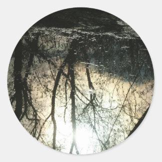 Reflections in water round sticker