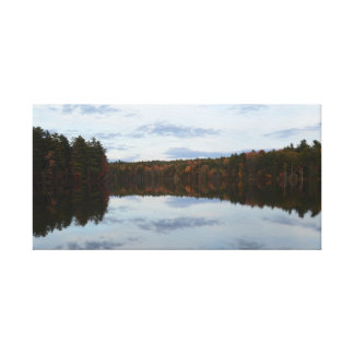 Reflections of Clouds and Fall Leaves on a Lake Canvas Print