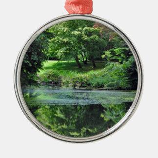 Reflective spring pond metal ornament
