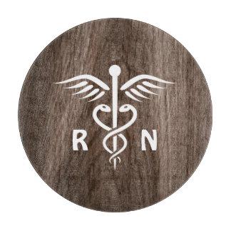 Registered nurse RN caduceus on wood background Cutting Board