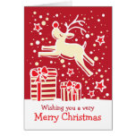 Reindeer prancing over gifts red Christmas card