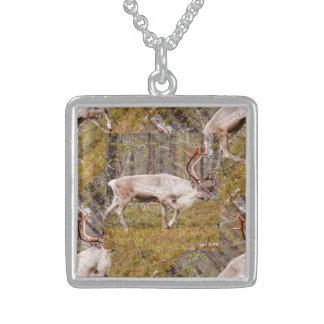 Reindeer walking in forest sterling silver necklace