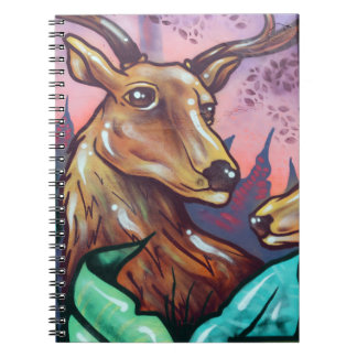 Reindeers resting in the forest notebook