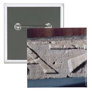 Relief depicting a stonemason's instrument 15 cm square badge