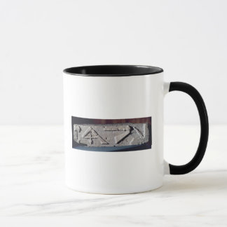 Relief depicting a stonemason's instrument mug