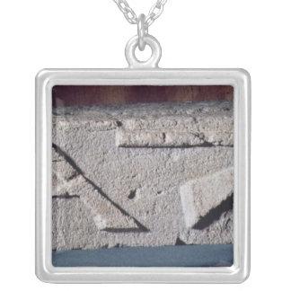 Relief depicting a stonemason's instrument square pendant necklace