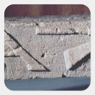 Relief depicting a stonemason's instrument square sticker