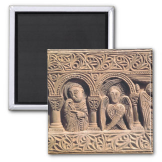 Relief depicting saints with a seraph magnet