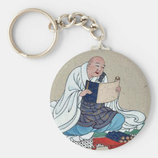 Religious figure reading a scroll key chain