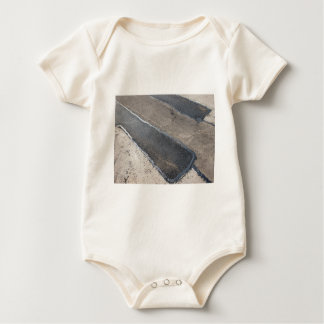 Repair pavement and laying new asphalt baby bodysuit