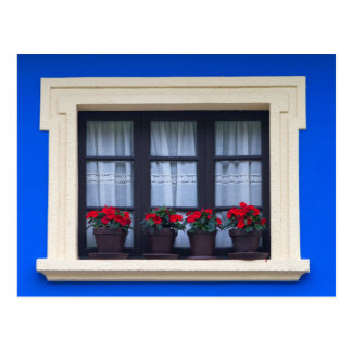 Residential housing with flowers in windows postcard