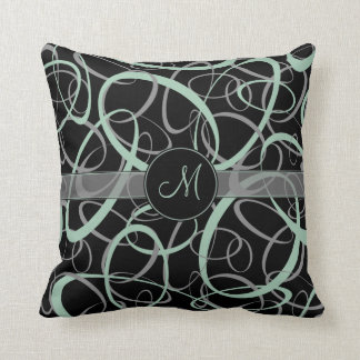 retro grayed jade and gray rings on black monogram cushion