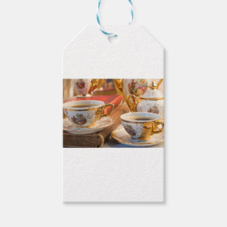 Retro porcelain coffee cups with hot espresso gift tags