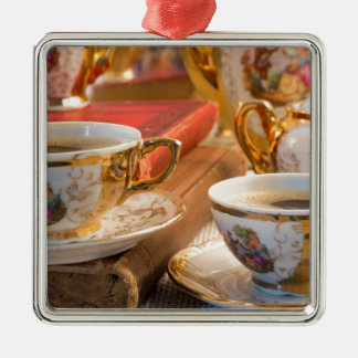 Retro porcelain coffee cups with hot espresso metal ornament