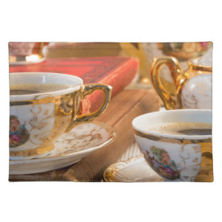 Retro porcelain coffee cups with hot espresso placemat