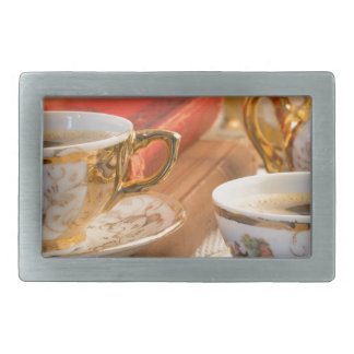 Retro porcelain coffee cups with hot espresso rectangular belt buckles