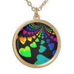 Retro rainbow hearts on black gold tone