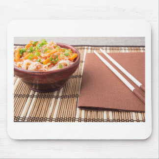 Rice vermicelli hu-teu in a small brown bowl mouse pad