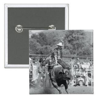 Rider hanging on to bucking bull 2 15 cm square badge