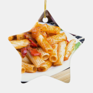 Rigatoni pasta, seasoned with pepper and arugula ceramic star decoration