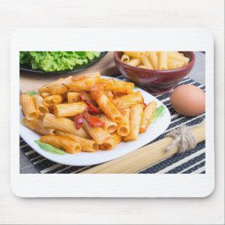 Rigatoni pasta, seasoned with pepper and arugula mouse pad