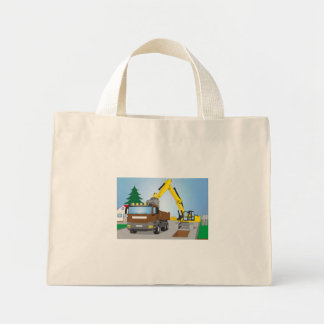 Road site with brown truck and yellow excavator mini tote bag