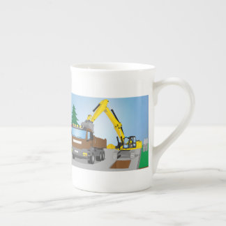 Road site with brown truck and yellow excavator tea cup